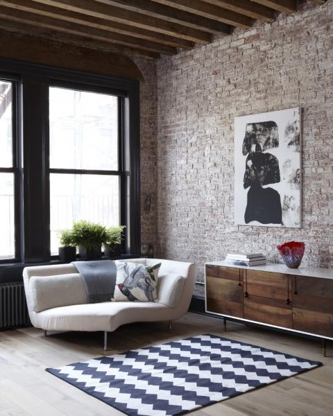 10 лучших вариантов кирпичных стен в гостиных