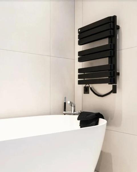 Как в Дании придумали экономить воду при помощи маленьких ванных комнат